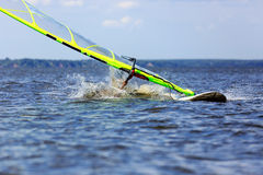 Windsurfer falls Stock Images