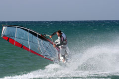Windsurfer Freestyle. Freestyle.For novice windsurfers, low wind freestyle tricks are an appropriate start; such as sailing backwards with the fin out of the Stock Images