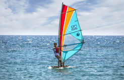 Windsurfer girl on the blue sea Royalty Free Stock Photography
