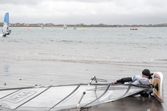Windsurfer having a rest on the beach Royalty Free Stock Photo