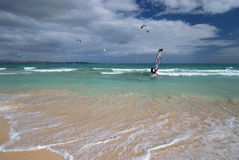 Windsurfer and kite surfers on the Atlantic Ocean. Windsurfer and kite surfers on the Grandes Playas Beach on Atlantic Ocean, Fuerteventura, Canary Islands Stock Photography