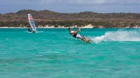 Windsurfer and kitesurfer Stock Images