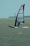 Windsurfer and lighthouse Royalty Free Stock Image