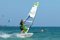 Windsurfer making duck jibe Stock Photo