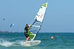 Windsurfer making duck jibe stock photo
