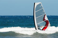 Windsurfer moving Stock Photos