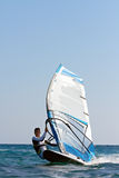 Windsurfer passing by Royalty Free Stock Photos