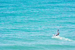 Windsurfer. A person alone doing windsurf in the sea Royalty Free Stock Photos