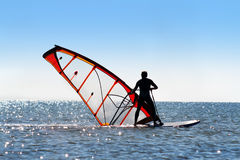 Windsurfer picks up the sail Royalty Free Stock Images