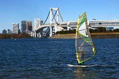 Windsurfer & Rainbow Bridge in Tokyo Royalty Free Stock Photos