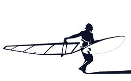 Windsurfer ready to ride. Windsurfer with board and sail on the beach ready to ride Royalty Free Stock Photography