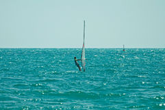 Windsurfer ride the wind Stock Images