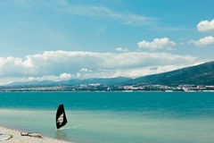 Windsurfer rides to shore along waves of Gelendzhik Bay Vacation Surfing Concept stock photo
