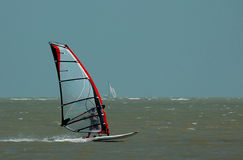 Windsurfer and sailboat Stock Photography