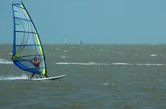 Windsurfer and sailboat II Stock Photos