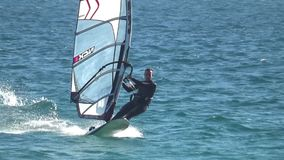 Practice of windsurf in Los Lances Beach in Tarifa. Windsurfer sailing in the beach of Tarifa in Spain in the province of Cadiz