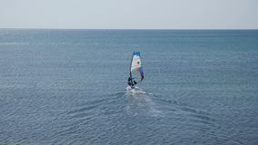 Windsurfer sailing board goes to the open sea stock video footage