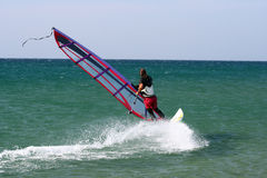 Windsurfer sailing freestyle. Stock Image