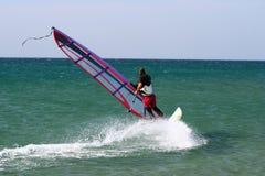 Windsurfer sailing freestyle. stock image