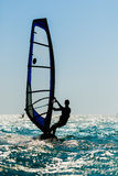 Windsurfer silhouette against sun Stock Photography