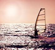 Windsurfer silhouette over sea sunset Stock Images