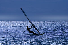 WINDSURFER after sunset. Royalty Free Stock Photos