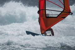 Windsurfer surfing the wind on waves. In ocean sea stock image