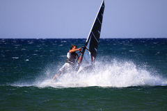 Windsurfer training in open sea. Royalty Free Stock Photo