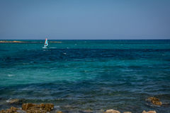 Windsurfer in turquoise sea in Sardinia, Italy Stock Photo