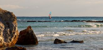 Windsurfer in waves. Stock Photos