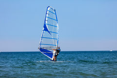 Windsurfer with windsurf on sea waves Royalty Free Stock Photo