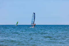 Windsurfer with windsurf on sea waves Stock Photography