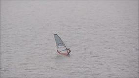 Windsurfer windsurfing on ocean stock footage