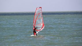 Windsurfer windsurfing. Video footage of a windsurfer windsurfing off the kent coast of whitstable on 15th sept 2015 stock video footage
