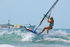Windsurfer women on wave Royalty Free Stock Image