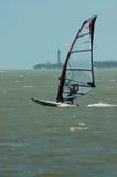 Windsurfer y faro Imagen de archivo libre de regalías