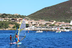 Windsurfers. Golfo Di Marinella, Sardinia, Italy, August 5, 2009 - People practicing windsurf Royalty Free Stock Images