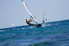 Windsurfers in action. On bright sunny day Royalty Free Stock Images