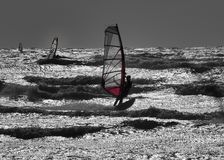 Windsurfers in action. Capture in light in my face creating beautiful effect Stock Photo