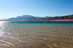 Windsurfers in blue lagoon in Dahab, Egypt Stock Image