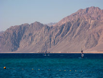 Windsurfers are in the Dahab's gulf. With the distant mountain background Stock Image