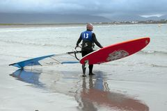 Windsurfers getting ready to go and surf. Windsurfer getting ready to race and surf on the beach in the maharees county kerry ireland Stock Photography