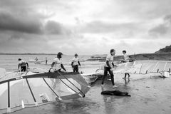 Windsurfers getting ready to race and surf in black and white Royalty Free Stock Photos