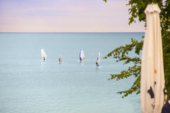 Windsurfers on the horizon. Stock Image