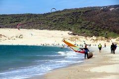Tarifa beach, the paradise of kitesurfing and windsurfing. Windsurfers and kitesurfers sailing in the beach of Punta Paloma in Cadiz, Spain Stock Photo