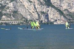 Windsurfers Learning. Windsurfers struggle to keep upright on a placid Lake Garda, Italy stock photography
