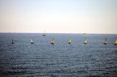 Windsurfers in a row on the mediterranean sea Royalty Free Stock Photos