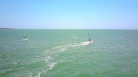 Windsurfers sail on ocean beginner fell into water stock video