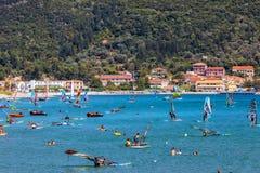 Windsurfers Sailing Across The Vasiliki Beach In Lefkada Island, Greece Royalty Free Stock Image