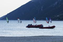 Windsurfers sailing at dusk in Vassiliki, Lefkada Greece royalty free stock image